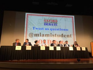 * candidates for City Council sit on stage
